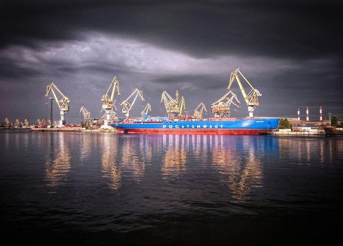 Ship moored at harbor