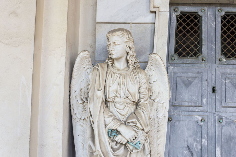 Angel statue by door of church