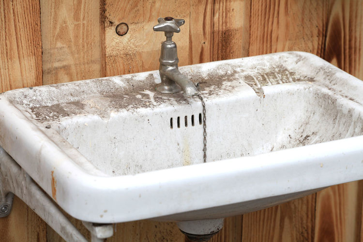Old dirty lavatory or washbasin Mold Rust Wall Bathroom Bathroom Sink Close-up Damaged Dirt Dirty Domestic Bathroom Domestic Room Faucet Home Household Equipment Hygiene Indoors  Lavatory Metal Nature No People Old Sink Water White Color Wood - Material