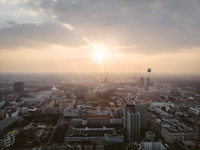Berlin Mitte DJI X Eyeem From Above  Aerial View Architecture Balloon Building Built Structure City Cityscape Clouds Day Dronephotography High Angle View Office Building Exterior Pollution Residential District Skyscraper Sun Sun Flare Sun Flares Sunbeam Sunrise Sunset Warm Light