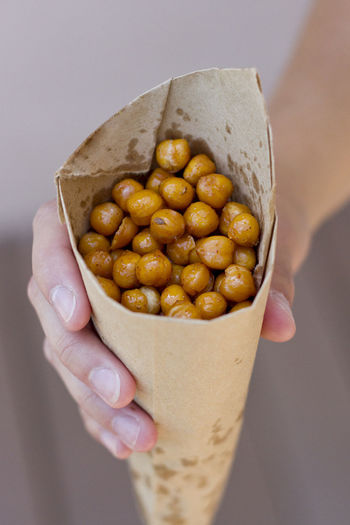 Homemade spiced roasted chickpeas in a paper cone. Cooking Adult Chickpeas Close-up Day Food Food And Drink Freshness Healthy Eating Holding Human Body Part Human Hand Indoors  Men One Person People Personal Perspective Ready-to-eat Real People Snacks