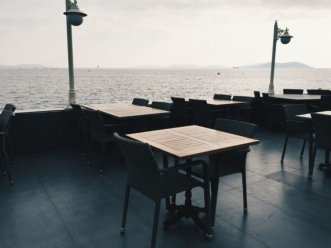 Empty restaurant terrace with no guests with the view at the Marmara sea Architecture Chair Empty Restaurant Horizon Over Water Island Istanbul Istanbul Turkey Lines Marmara Sea Nature No People Outdoors Peaceful Restaurant Sea Sunny Weather Sunny Winter Day Table Tables Terrace Tranquility Turkey Water Winter