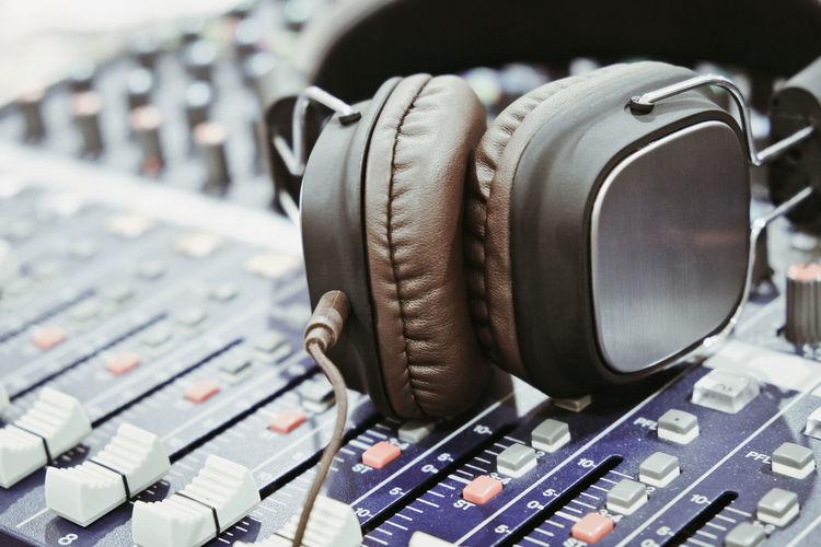 Close-up of headphones on audio equipment