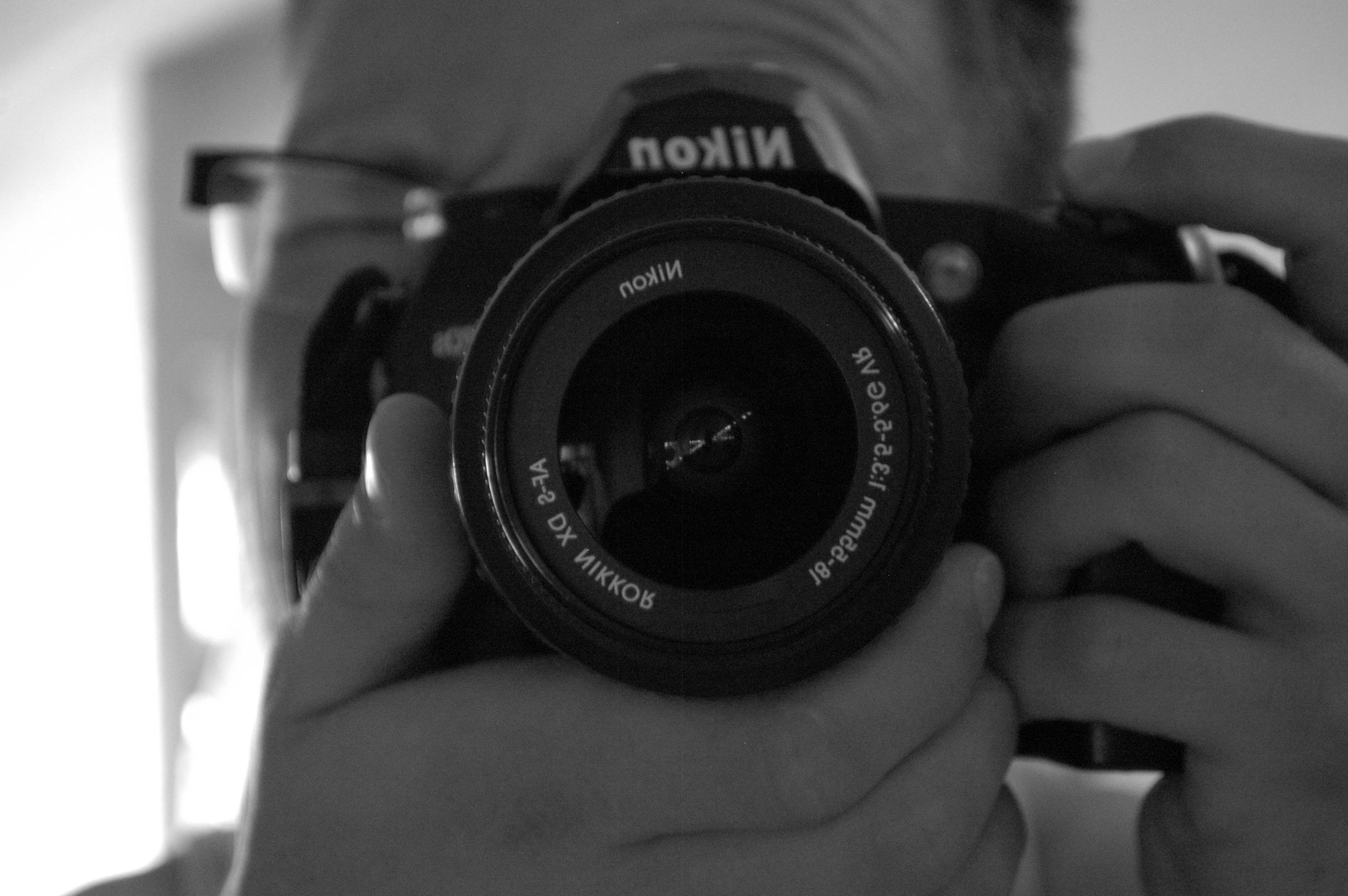 indoors, technology, photography themes, close-up, part of, camera - photographic equipment, focus on foreground, person, cropped, digital camera, lens - optical instrument, photographing, selective focus, old-fashioned, retro styled, holding, reflection