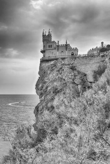 Swallow's nest, scenic castle and iconic landmark over the Black Sea in Yalta, Crimea Architecture Building Building Exterior Built Structure Castle Cloud - Sky Day History Horizon Horizon Over Water Land Nature No People Outdoors Scenics - Nature Sea Sky The Past Travel Travel Destinations Water