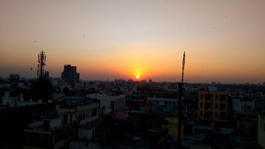 Love This. Evening Sunset 🌇 View. Eyeemweekly Day Lovetotravel Travel Travel Photography Kite Flying Evening Sunset Sunsetview Sky Colors Beauty In Nature EyeEm Best Shots EyeEmNewHere EyeEm Nature Lover EyeEm Gallery EyeEm Selects EyeEmBestPics Mobilephotography Cityscape City Sun Sky Dramatic Sky Urban Skyline No People Architecture Building Exterior Outdoors Nature