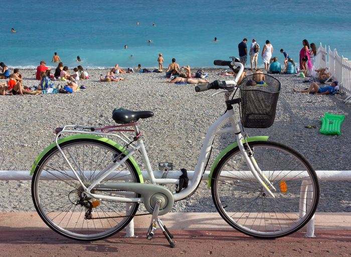 View of bicycle against people on beach