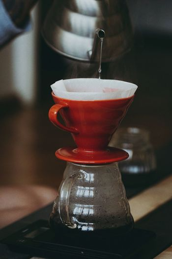 Close-up of coffee cup on table at home