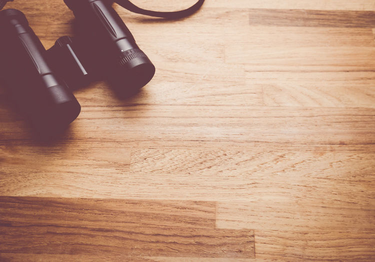 binoculars on a wood surface Binoculars Close-up Elevated View Flooring Hardwood Floor No People Objects Optical Instruments Part Of Selective Focus Still Life Top View View From Above Wood - Material Wooden