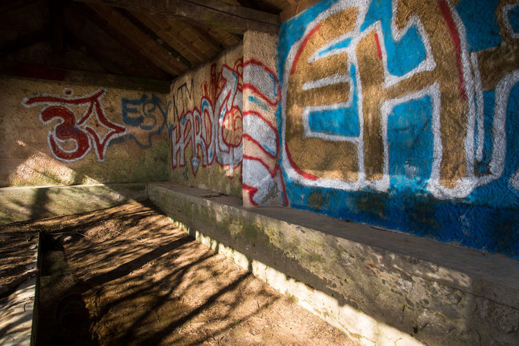 Graffiti Architecture Art And Craft Multi Colored No People Creativity Shadow Indoors  Day Wall - Building Feature Pattern Sunlight Wall Paint Mural Built Structure Nature History Floral Pattern Old The Past Vandalism Abandoned Laundry Laundry Area Bad Condition Deterioration Painted Damaged Worn Out