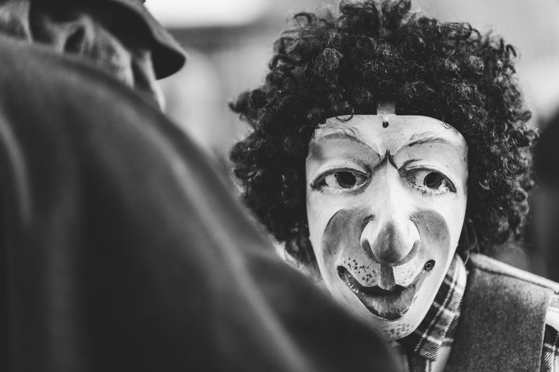 Ancient carnival of sauris. traditional wooden masks. black and white. italy