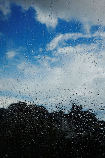 Backgrounds Blue Sky And Clouds Blue Sky And White Clouds City Street Close-up Cloud - Sky Clouds Day Drop Full Frame Nature No People Outdoors Rain RainDrop Rainy Days Rainy Season Silhouette Sky Transparent Water Wet Window