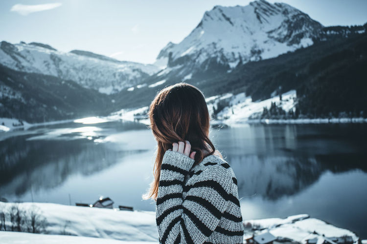 Woman looking at snowcapped mountains during winter