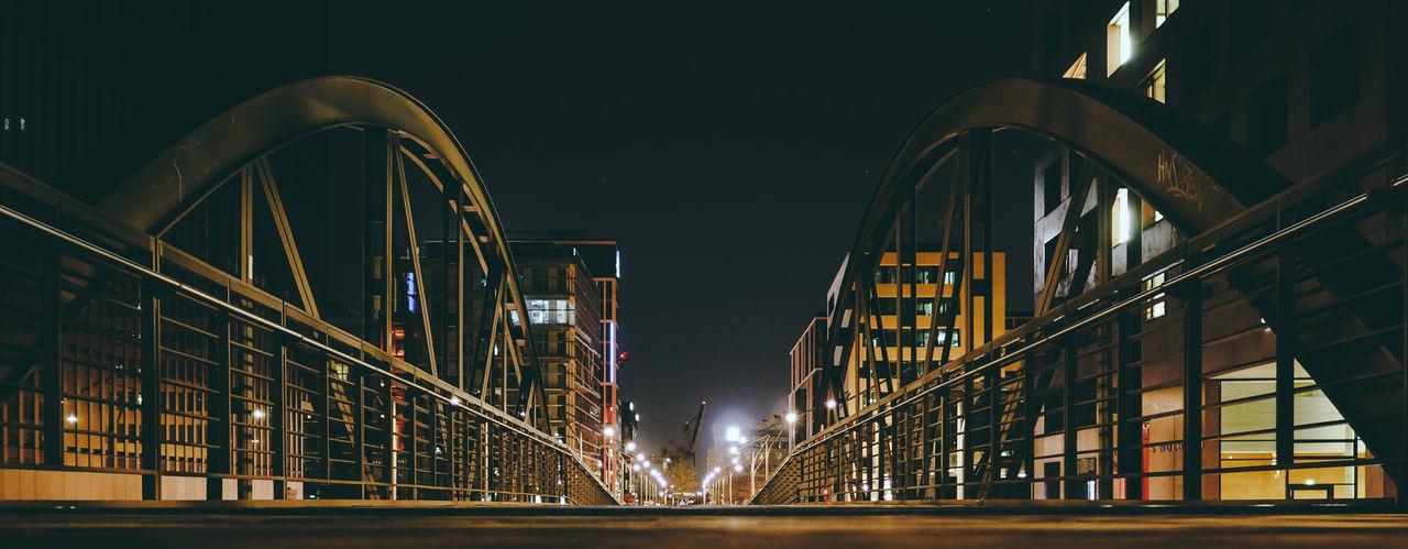 Panoramic view of illuminated bridge against sky at night