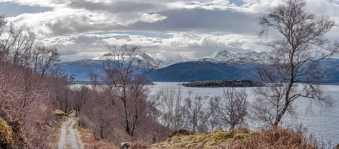 Scotland 💕 Bare Tree Beauty In Nature Cold Temperature Day Fresh Water Loch Lake Landscape Mountain Nature No People Outdoors Photo Merge Photography Scenics Sky Snow Tranquil Scene Tranquility Tree Water Wilderness Winter Snow Covered Cold Weather Condition Idyllic Remote Countryside Calm Snowcapped Mountain