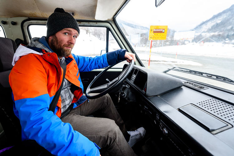 Delivery Delivery Service Industry Lorry Traffic Transport Transportation Winter Car Cold Day Driving Land Vehicle Men Mode Of Transportation Motor Vehicle One Person Outdoors Real People Transportation Truck Trucker Van Vehicle Interior