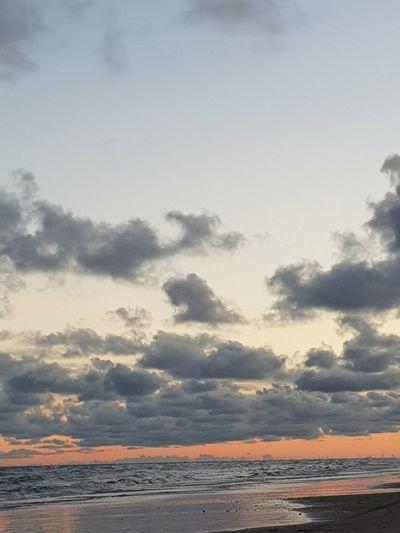 peachy skyes Seascape Landscape Beach Water Low Tide Sea Sunset Beach Horizon Wave Blue Sand Silhouette Romantic Sky Coastal Feature Atmospheric Mood Moody Sky Majestic Coastline Cloudscape The Great Outdoors - 2018 EyeEm Awards