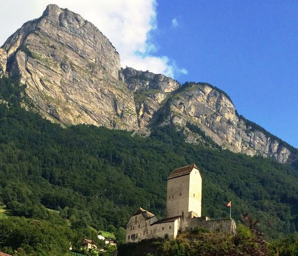 Low angle view of sargans castle by mountain against sky