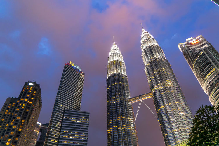 Sunset at Petronas Twin Towers KLCC, Kuala Lumpur Building Exterior Architecture Built Structure Building Office Building Exterior City Skyscraper Sky Tall - High Tower Modern Office Illuminated Urban Skyline Travel Destinations Low Angle View Nature Cityscape Landscape Financial District  No People Outdoors Spire
