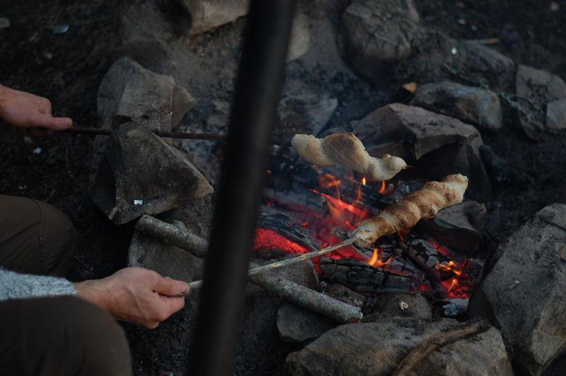 Cropped image of man cooking food