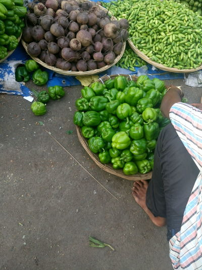 Low section of man selling vegetables at street market