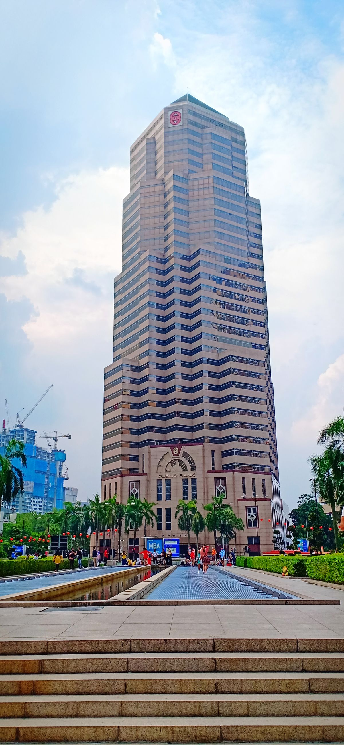 architecture, built structure, building exterior, city, building, sky, cloud - sky, office building exterior, nature, skyscraper, plant, incidental people, office, modern, tall - high, day, staircase, outdoors, tower, low angle view