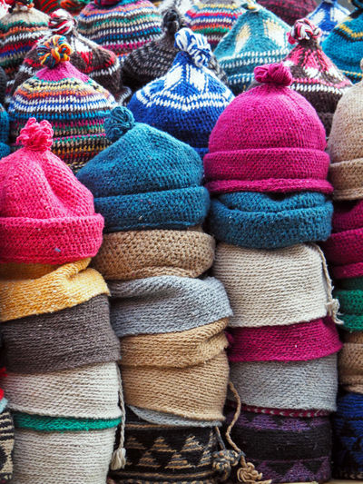 Stack Of Woolen Hats For Sale At Market Stall