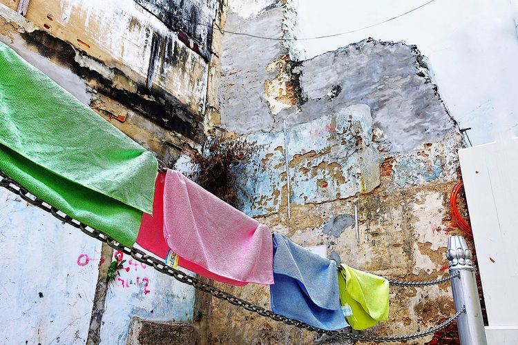 Clothes drying against wall in abandoned building