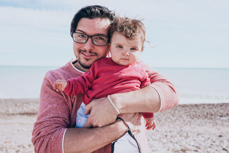 Portrait of father and son on beach