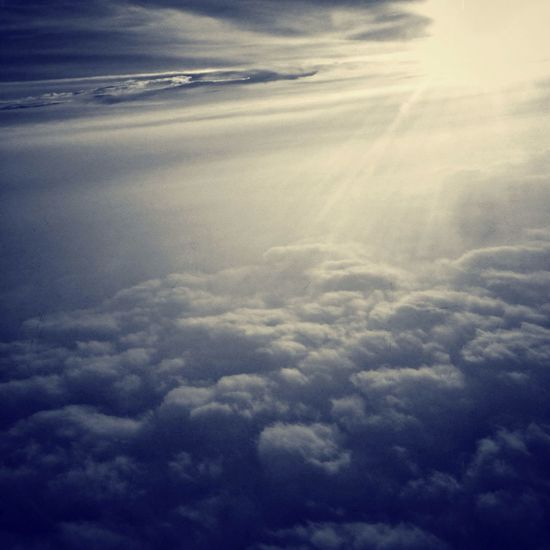 Search of light From An Airplane Window Clouds And Sky Monochrome Travelling