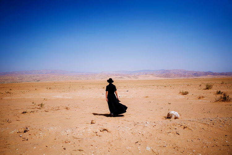 Full length of woman on desert