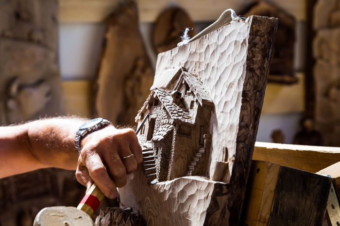 Art And Craft Artist Carving - Craft Activity Carving - Craft Product Clay Close-up Craft Creativity Focus On Foreground Hand Tool Holding Human Body Part Human Hand Men Midsection Occupation One Person Real People Sculptor Sculpture Skill  Wood - Material Work Tool Working Workshop
