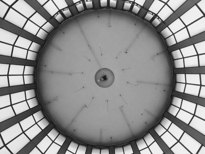 Low angle view of clock on ceiling