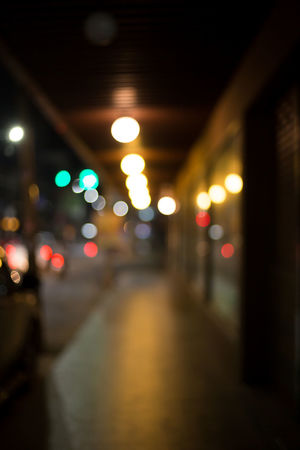 Architecture Background Bokeh Built Structure Ceiling City Defocused Diminishing Perspective Direction Footpath Illuminated Light Light - Natural Phenomenon Lighting Equipment Mode Of Transportation Night No People Outdoors Road Street Street Light The Way Forward Transportation Vehicle Light