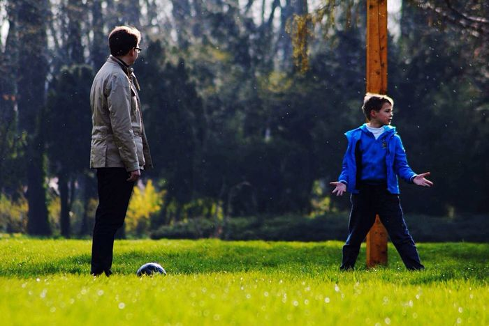Fatherhood Moments Joy Of Life Leisure Activity Grass Casual Clothing Nature Grass Green Kid Playing Father & Son Father Love Outdoors Relaxing Taking Photos