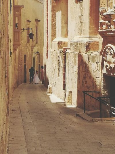 City Corridor Architecture Building Exterior Built Structure Narrow Alley Lane Old Town Building Long Aged Passage Historic Residential Structure Ancient Civilization Civilization Pathway Path Townhouse Destinations Walkway Passageway Wall Lamp