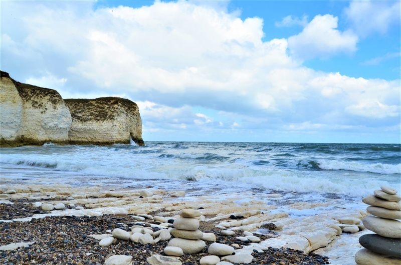 Water Sea Sky Beach Cloud - Sky Land Horizon Over Water Horizon Scenics - Nature Beauty In Nature Rock Nature Tranquil Scene Tranquility Solid Rock - Object No People Day Motion Pebble Outdoors