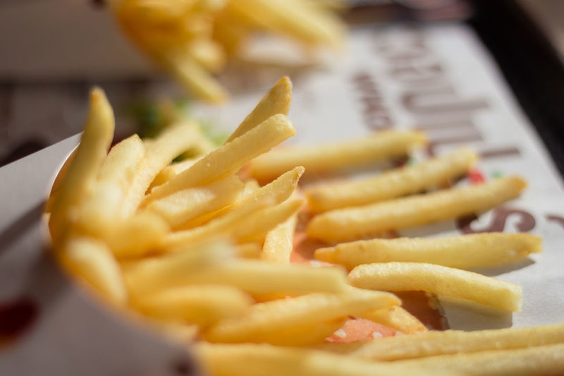 Close-up Day Deep Fried  Fast Food Fast Food French Fries Food Food And Drink French Fries Freshness Indoors  No People Paper Plate Prepared Potato Ready-to-eat Unhealthy Eating Yellow