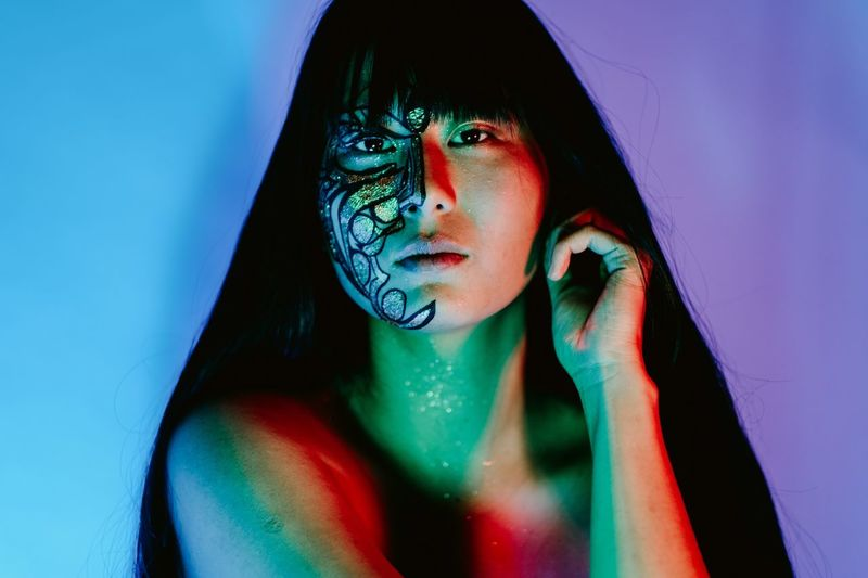 Me painted and photographed by Liliana Hopman Neon Lights Neon Black Light Effect Black Light Body Paint Black Light One Person Young Adult Young Women Portrait Real People Indoors  Front View Looking At Camera Make-up Women Headshot Lifestyles Adult Leisure Activity Fashion Studio Shot Face Paint Beautiful Woman Eyeshadow Blue