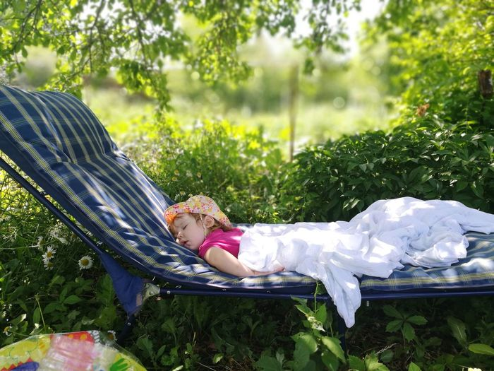 undisturbed children's sleep Sleeping Dream Dreaming Child Natural Beauty Nature Low Section Happiness Childhood Smiling Lying Down Shoe Front Or Back Yard Summer Grass Petal