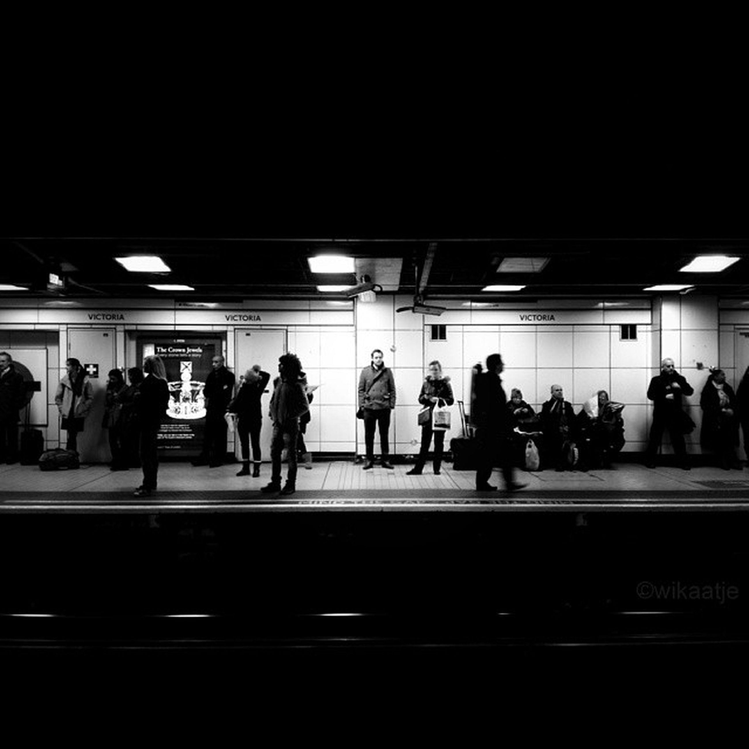 men, indoors, railroad station, transportation, public transportation, person, railroad station platform, illuminated, walking, subway station, large group of people, lifestyles, rail transportation, subway, passenger, architecture, built structure, waiting, travel