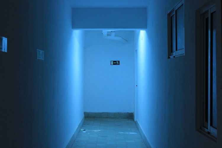 Absence Alley Architecture Bathroom Blue Building Built Structure Communication Corridor Dark Door Empty Entrance Indoors  Leaving Lighting Equipment Mystery Night No People Old Public Building Public Restroom Sign Spooky