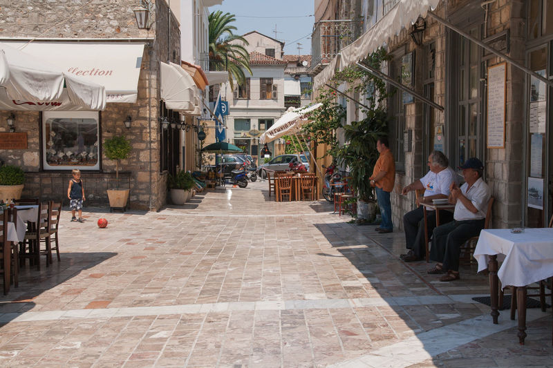 Football Afternoon Architecture Boy Building Exterior Built Structure Child City City Life Cobblestone Father Father And Son Football Greece Incidental People Lazy Time Men Nafplio Peloponesse Person Playing Son Street The Way Forward