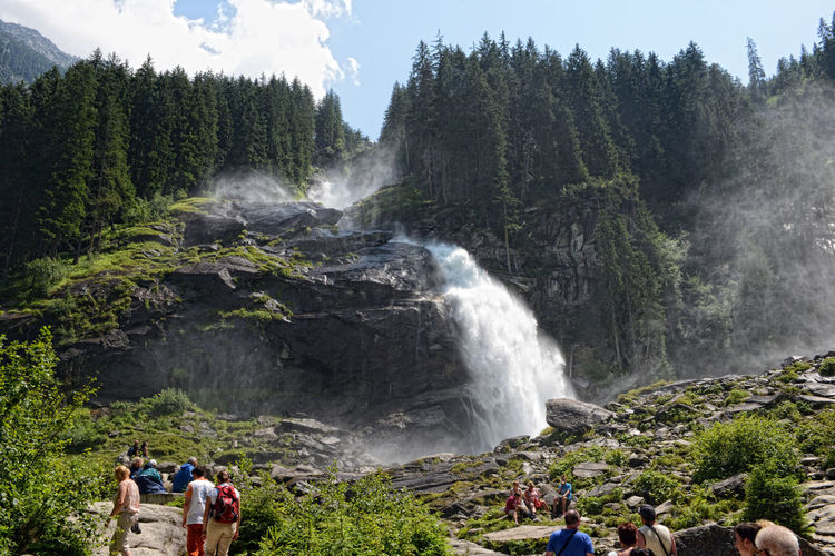 People visiting Krimml waterfalls in Austria at summer time. Part of High tauern mountain range national park Alps Austria European Alps High Tauern Hiking Hohe Tauern Krimml Krimml Waterfalls Krimmler Wasserfalle Krimmlerwasserfälle Landscape Mountain National Park Nature Salzburger Land Tourism Tourist Travel Travel Destinations Vacations Waterfall Waterfalls Österreich