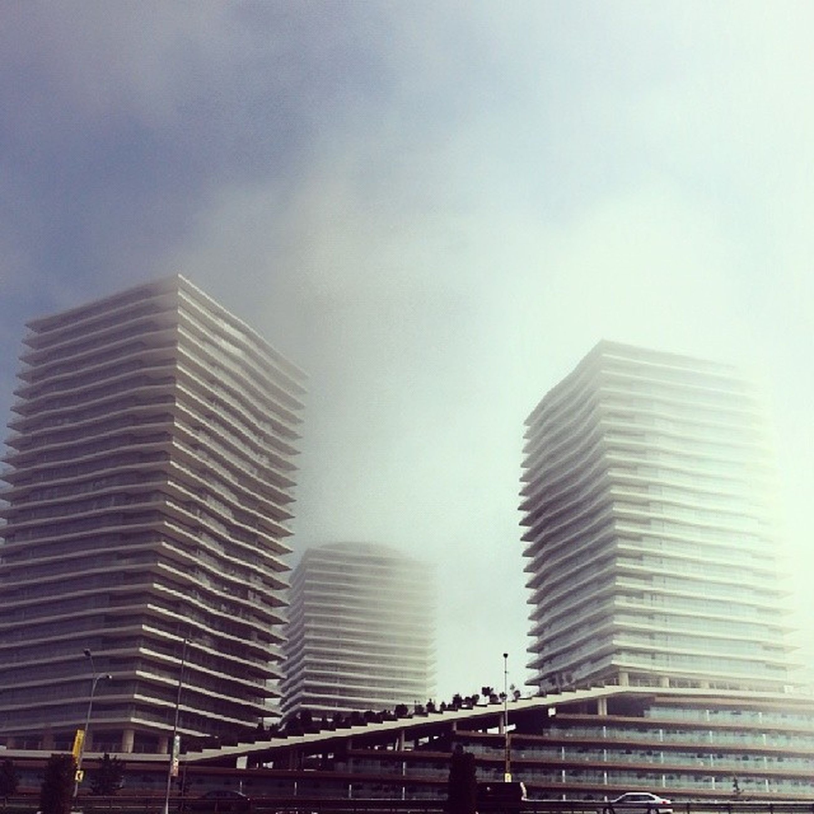 architecture, built structure, building exterior, modern, low angle view, skyscraper, office building, city, glass - material, sky, tall - high, building, tower, day, reflection, outdoors, city life, no people, development, clear sky