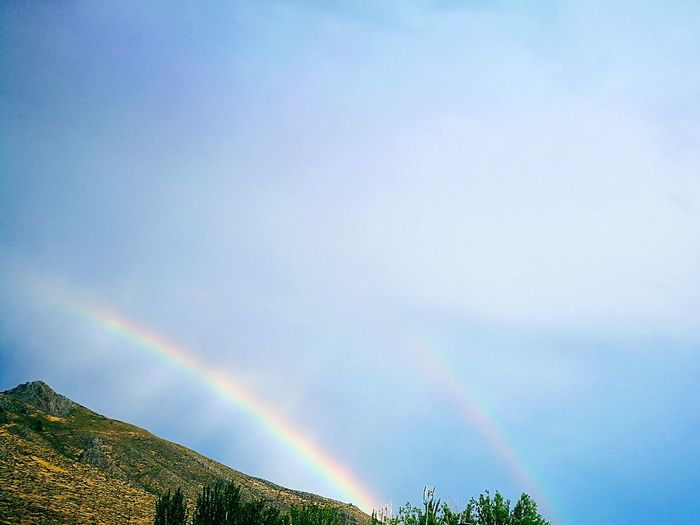 Double rainbow Double Rainbow Rainbow Sun Nature Light Relaxing Tranquility Elegant Mountain EyeEm Selects Cloudy