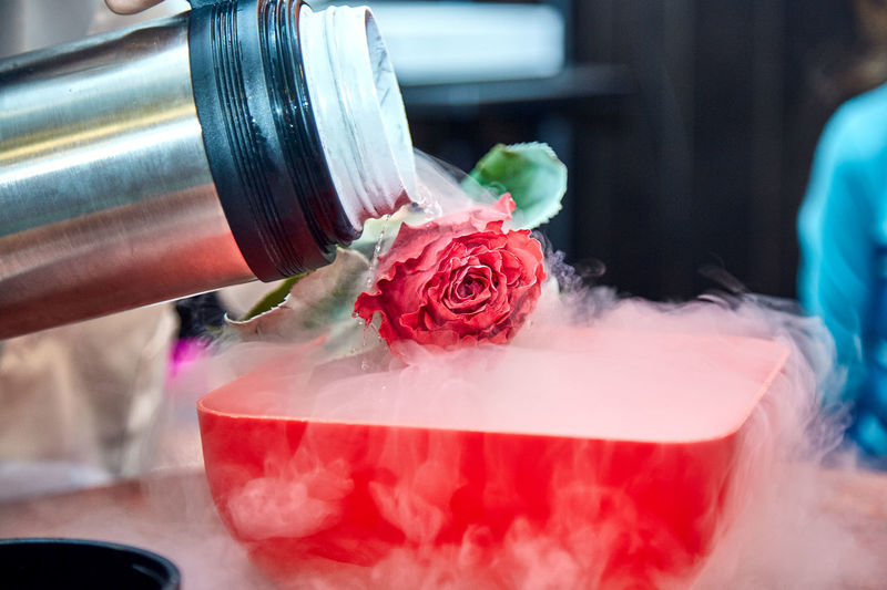 Water being poured on rose in container