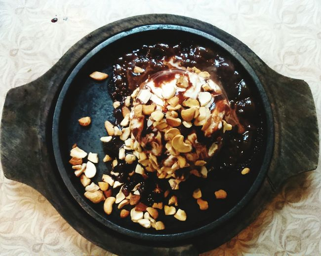 Close-up of sizzling brownie on table