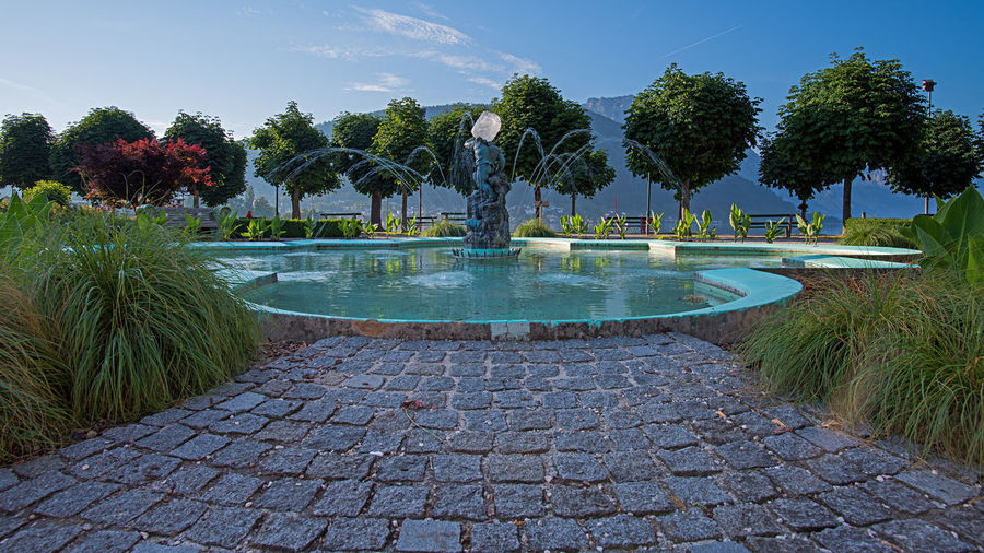 View of swimming pool in park against sky