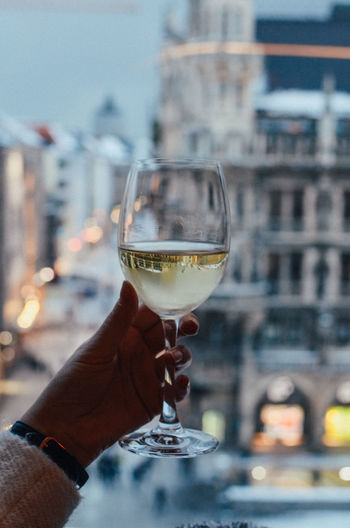 Human Hand Hand Human Body Part Holding One Person Food And Drink Wine Refreshment Drink Focus On Foreground Real People Alcohol Building Exterior Built Structure Wineglass Glass Architecture Lifestyles City Personal Perspective Body Part Finger Outdoors Luxury